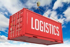 Logistics - Red Hanging Cargo Container on Sky Background.